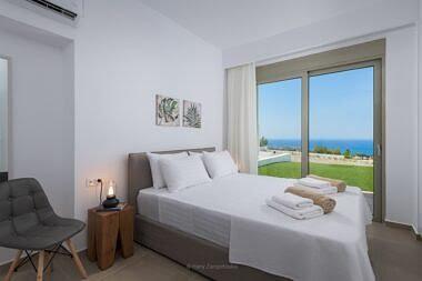 Bedroom-2-3-380x253 Villa Dione - Pefkos Hill Villas - Harry Zampetoulas Photography